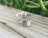 The Arrow Wrap Ring in Sterling Silver. Made to order adjustable ring in your size.