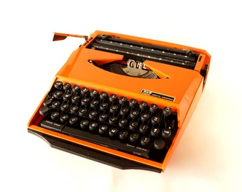 Vintage Smith Corona Karmann Ghia Super G Portable Typewriter in Orange and Black (c.1970s) - Hard-to-Find Collectible Typewriter