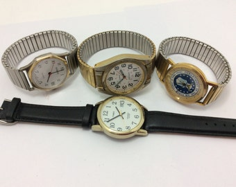 Lot of 4 vintage watches for parts or need batteries
