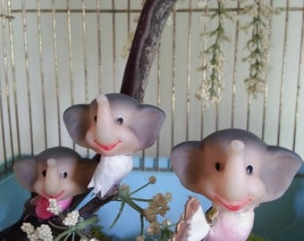 Handmade elephant birds in vintage bird cage