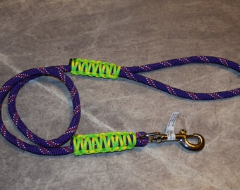 dog leash pictured is made of purple utility rope and yellow/green 550 paracord