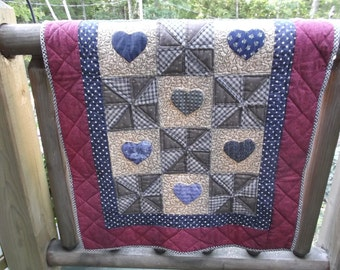 hearts and pinwheels quilted wall hanging