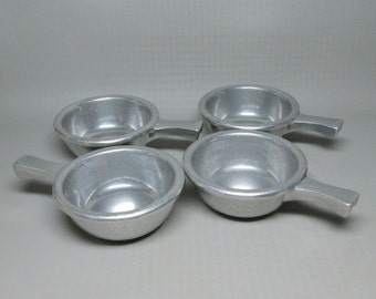 set of four Pewterex tab handle bowls , Old Country Reproductions York PA ,