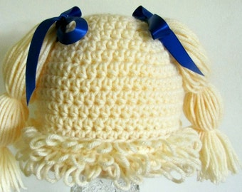 Cream (pale blond) Cabbage patch wig/hat for baby-toddler 18-24 months. You choose bow color
