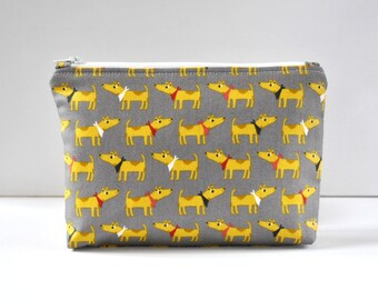 Woman's padded travel make up pouch bandanna wearing dog novelty animal print in yellow and grey in large.