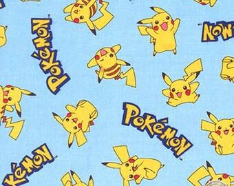 140151248 - Pokemon Pikachu Light Blue Cotton Fabric By The Yard Pokeball