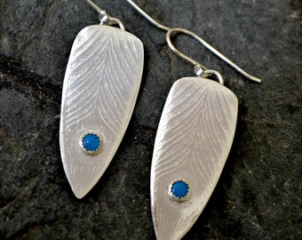 Long Sterling silver peacock post earrings with blue chalcedony.