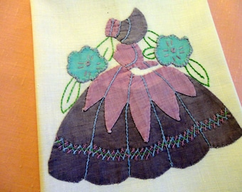 "Vintage Towel 1950s - Handmade Applique, Sun Bonnet Girl, ceamy/white, purple, lavender & aqua, faded to soft shades, 19"" long by 12"" wide"
