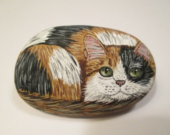 Calico Cat hand painted on a stone - pet rock - by Ann Kelly