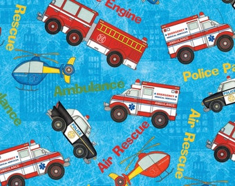 HELP is on ITS WAY~by the 1/2 yard Wilmington fabric police car, ambulance, fire engine air rescue tossed on blue