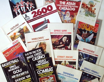 Lot of 26 Pieces of Atari Game Instruction Manuals, DC Atari Force Comic Book, Atari Catalog, Etc., Pac Man, Moon Patrol, Defender