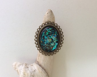 Galaxy ring/ oval Hologram ring/iridescent green/ blue/ gold/turquoise on dark blue/black background/ antique bronze band/ filigree lace