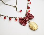 Leather red bow necklace. Spring accessories. Golden locket. Genuine leather bow pendant. Red swarovski and ruby beads. Bohochic