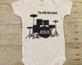 With the Band Christian bodysuit SIZES 3, 6, 9, 12 or 18 month.  Jesus is the one we follow.  Unique baby shower gift.