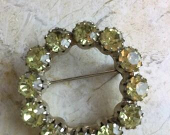Lovely light yellow rhinestone brooch
