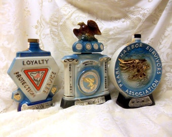 Three Commemorative Jim Beam Collectible Decanters