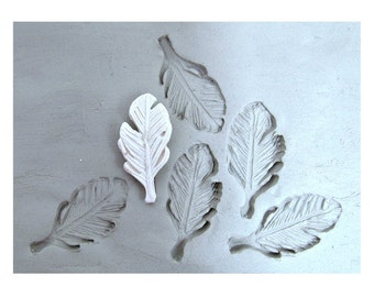 clay stamps -pottery tools -metalstamps -soapstamps -bisque stamps -ceramic stamps - -feather stamp -  (240)