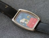 Vintage Quartz Snoopy watch with original strap and tin and outer box