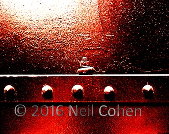 Abstract red color archival inkjet photograph of rivets and nut and bolt