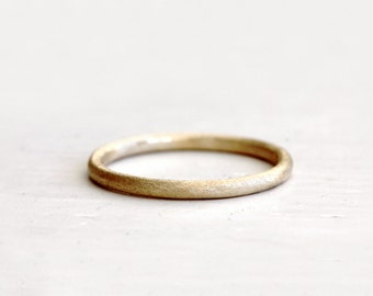 A simple wedding ring. Earthy love. Ford