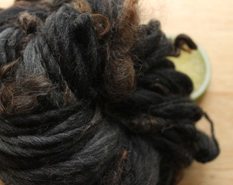 Charcoal - Thick and Thin Handspun Merino Wool Yarn with Curls