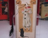 RESERVED 4 D halloween bridge tally flapper dressed in clown costume holding a candle and frightened by a black cat jack o'lanterns