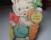 Adorable 1940's die cut easter greeting card cute bunny dressed in a jumper holding a huge carrot