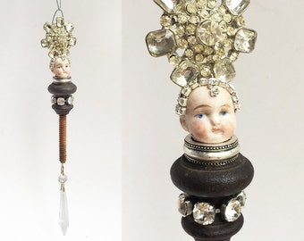 mixed media assemblage, snowflake ice queen, an original art doll ornament, encrusted jewelry ornament, by Elizabeth Rosen