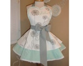 Dandelion Print Woman's Retro Apron Accented In Mint Green, Featuring Custom Embroidered Heart Shaped Bib
