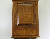 Tiger Maple Cabinet