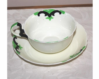 Hand painted Tuscan china cup and saucer. Plant pattern. Art Deco