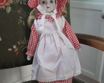porcelain doll- china doll- girl doll- gingham dress- bonnet- Blonde hair doll