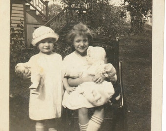 Sisters BFFs Baby Dolls holding Baby Dolls snapshot portrait vernacular photography found photo social realism