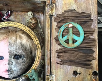 Innocents in Conflict assemblage art altered doll head