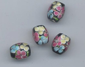 Nine pretty floral lampwork glass beads - 12.5 x 10 mm