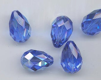 Six vintage Swarovski crystal beads - Art. 5500 - 16.5 x 11 mm - sapphire AB