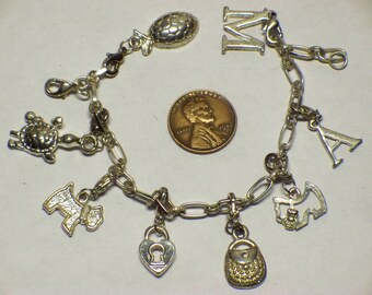 ladies base metal charm bracelet E-375