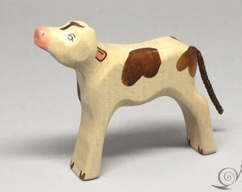 Toy calf wooden white  brown spots bellowing Size: 9,5 x 8,0  x 2,0 cm (bxhxs) approx. 33,5 gr.