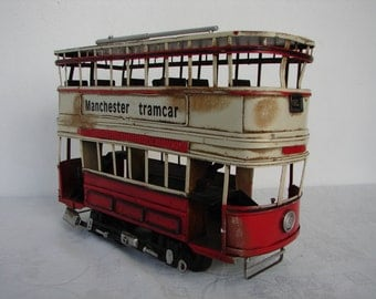 vintage 1903 style, tinplate Manchester tramcar, double decker, red cream, old transport model