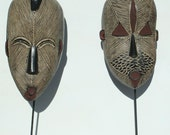 Pair of Wooden Hand Crafted Masks from The Cameroons in Africa -  Stands included