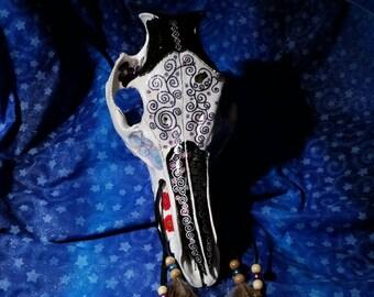 hog skull.bone art. hand painted  skull with feathers.