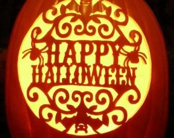 Happy Halloween scene on a hand-carved foam pumpkin for Halloween decorating
