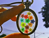 Floral Rainbow Pendant Necklace, Real Flowers preserved in Resin, enclosed in Vintage Bronze Oval Pendant. Bronze Chain.