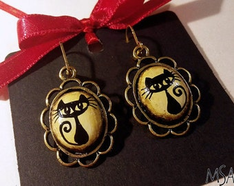 Handmade wooden earrings with black cats in golden coloured frames (beige, brown, gold colour)