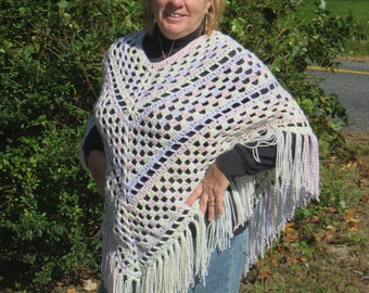 Crochet Poncho just completed with a lite multi color tweed in the yarn