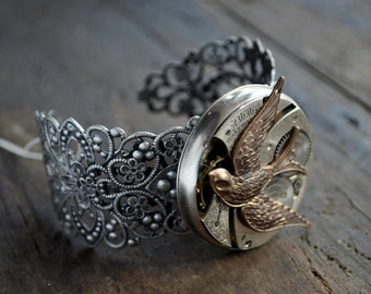Beautiful Silvertone Filigree Cuff Bracelet with Antique Etched Pocket Watch Movement Antique Gold Toned Swallow Bird Unique & One Of A Kind