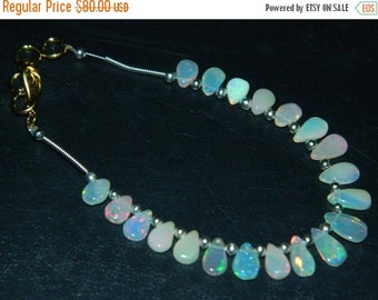 20%off. AAA Ethiopian Opal Smooth Pear Briolettes -Great Quality-Opal Beads-Size 8 - 9mm. Long Approx