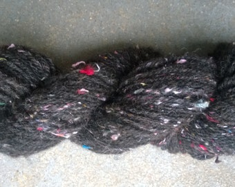 Handspun Yarn: Shetland Wool Tweed. Black with Sari Silk Threads