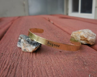 Brass cuff etched with the word - Begone
