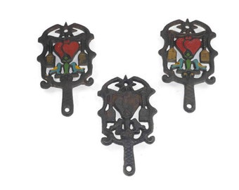 3 Small Cast Iron Trivets 1 Brown Stove Works and 2 Wilton